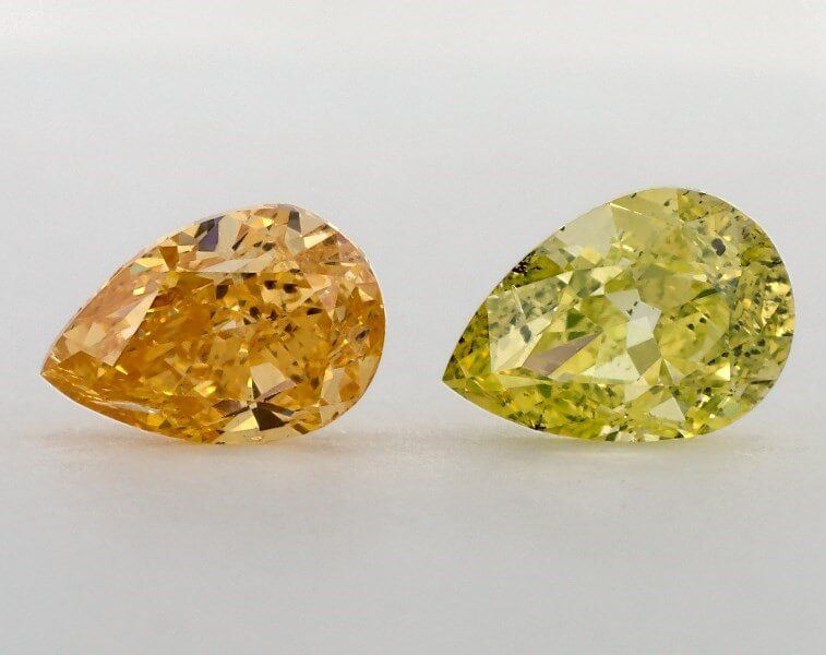 Pair of Fancy Vivid Orange Yellow, 1.10 & 1.01 Carats, I1 Clarity, GIA