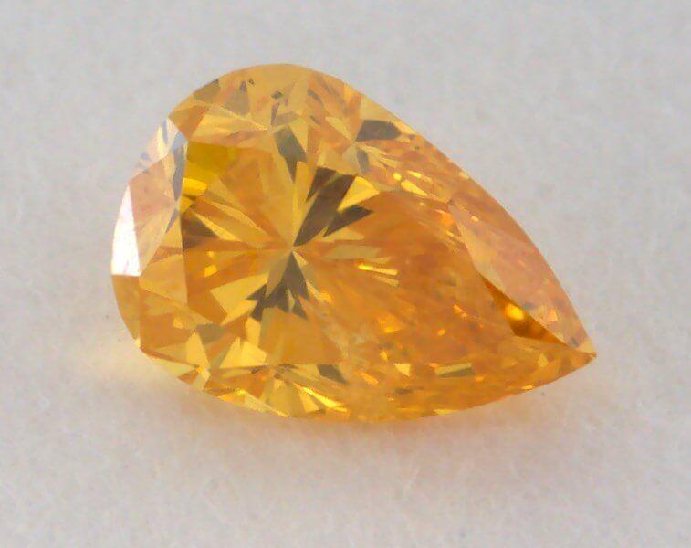0.10 Carat, Natural Fancy Vivid Orange-Yellow Diamond, I1 Clarity, Pear Shape, GIA