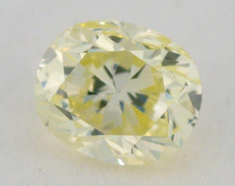 0.23 carat, Natural Fancy Light Greenish Yellow, Radiant Shape, VS2 Clarity, IGI