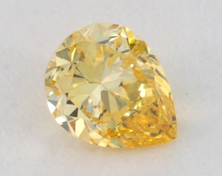0.34 carat, Natural Fancy Yellow, Pear Shape, SI2, IGI