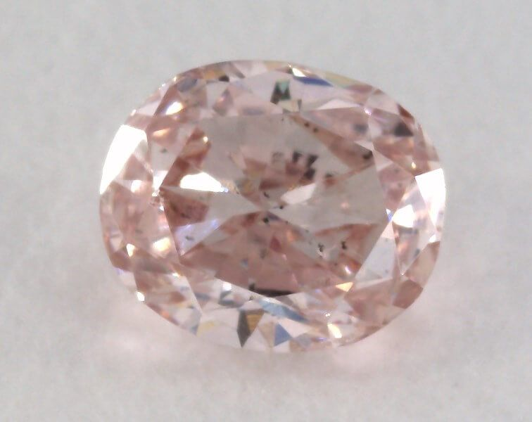 0.19 Carat, Natural Fancy Light Pink Brown Diamond, SI1 Clarity, Oval Shape, IGI